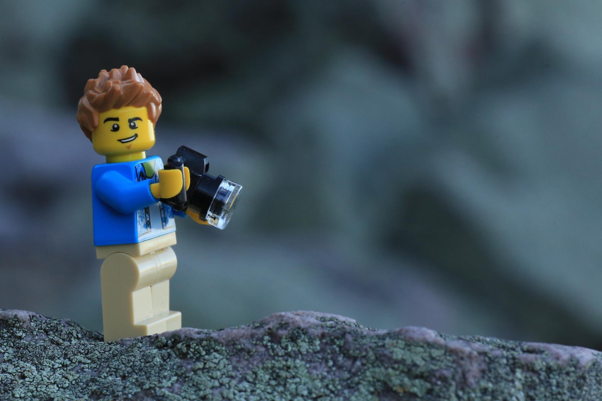 LEGO minifigure holding a camera
